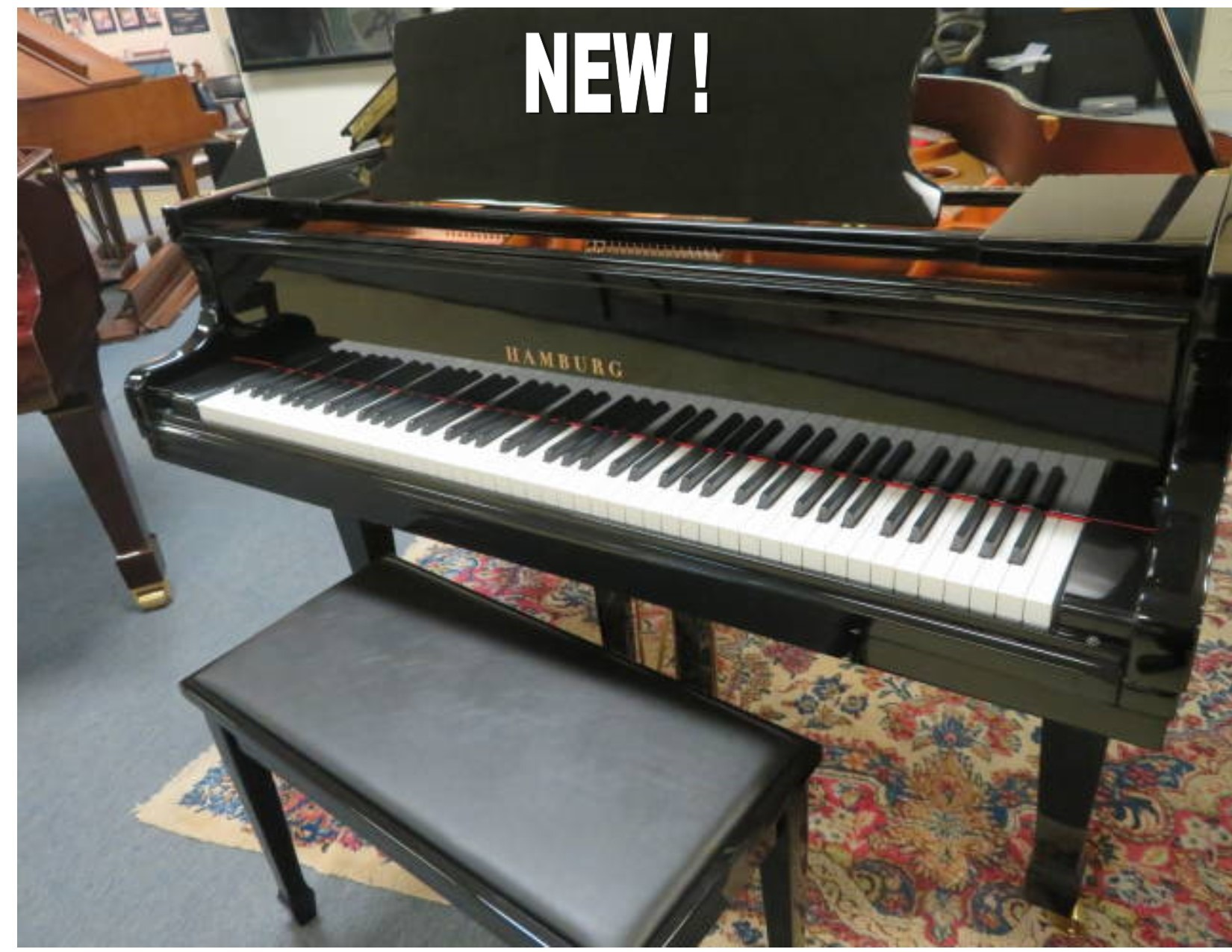 "12656-<br><font color=black><b>NEW HAMBURG</b></font> 6'2″ GRAND PIANO -""BEST KEPT SECRET IN THE PIANO BUSINESS"" GERMAN WIDE TAIL DESIGN, EUROPEAN SOUND!"